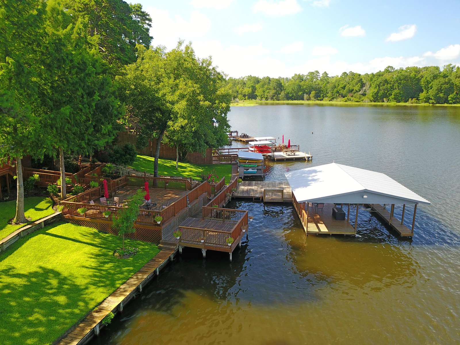 The lower porch (with firepit) and boat dock as viewed from our drone.