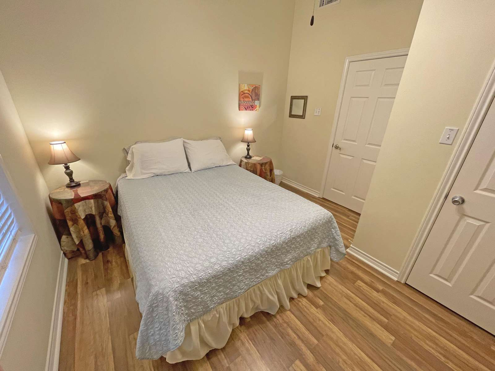 The lower queen bedroom located across from the lower hall bathroom.