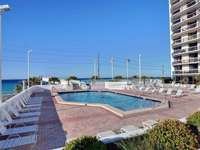 Sufside's pool deck features a large pool, 2 hot tubs, a kiddie pool, and a tiki bar. thumb