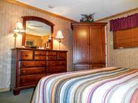 Plenty of storage in master bedroom (armoire and dresser) thumb