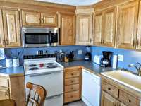 Fully-equipped kitchen includes pots, pans and utensils thumb