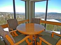 Mountain Lodge sitting areas overlook slopes and mountains thumb