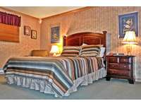 Master bedroom w/ queen bed and private full bath thumb