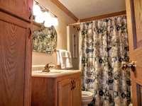 Hallway bathroom includes tub and shower thumb