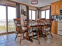 Table seats six (6) comfortably thumb