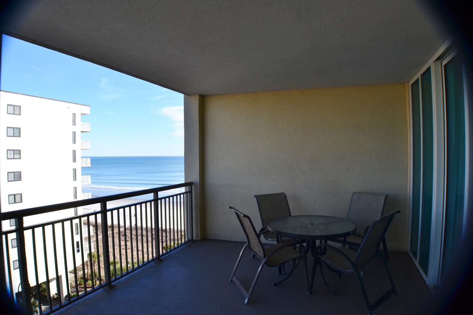 Spacious balcony with sunrise and ocean views