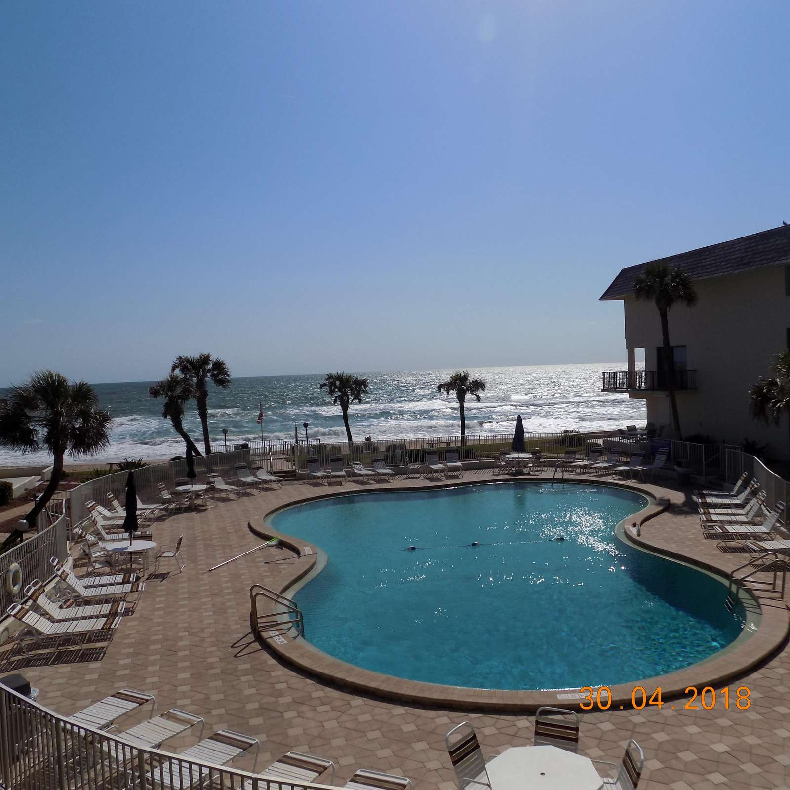 """Wonderful ocean and pool view from apartment""""."""