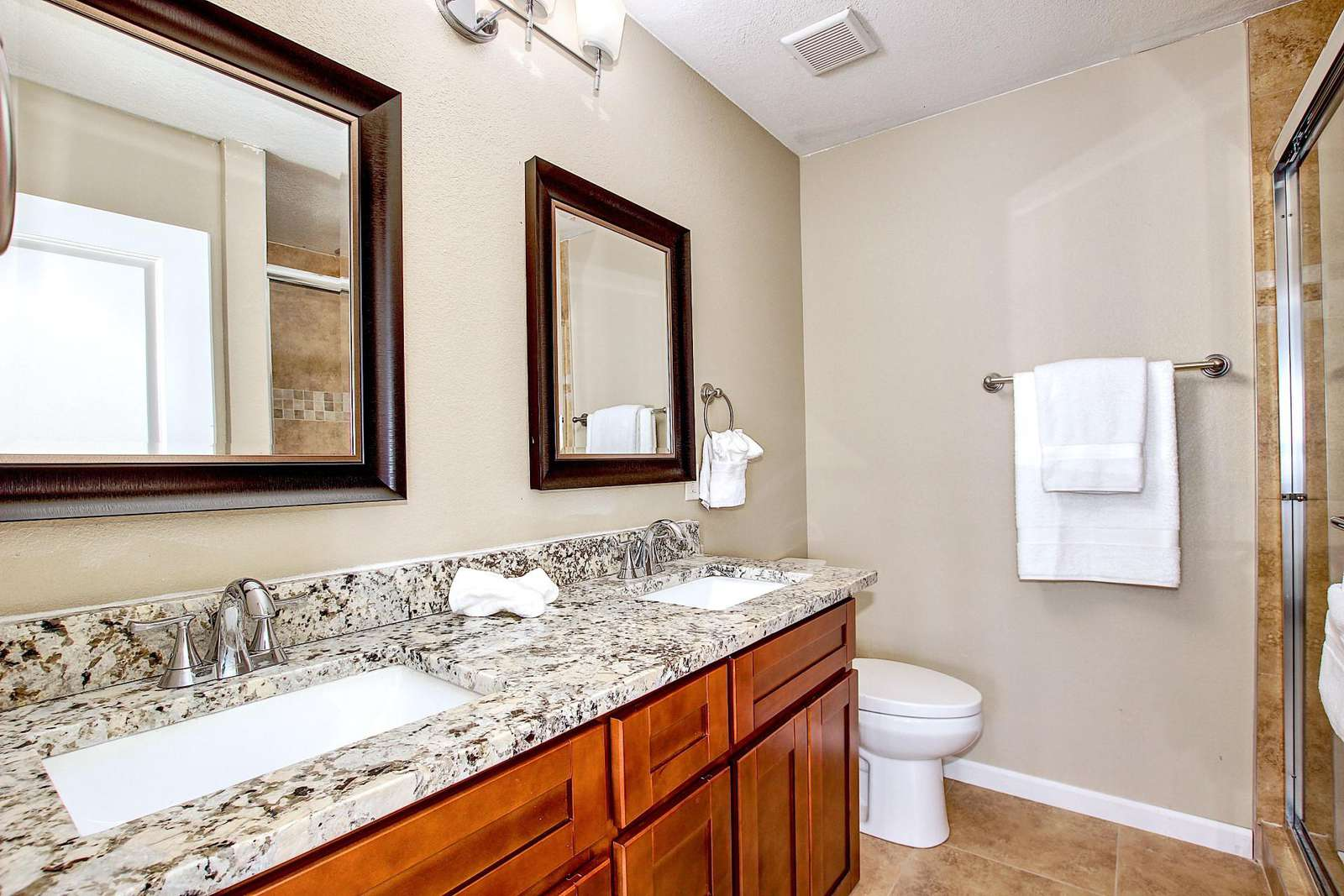 5th bedroom bath has a double vanity and large walk in shower.