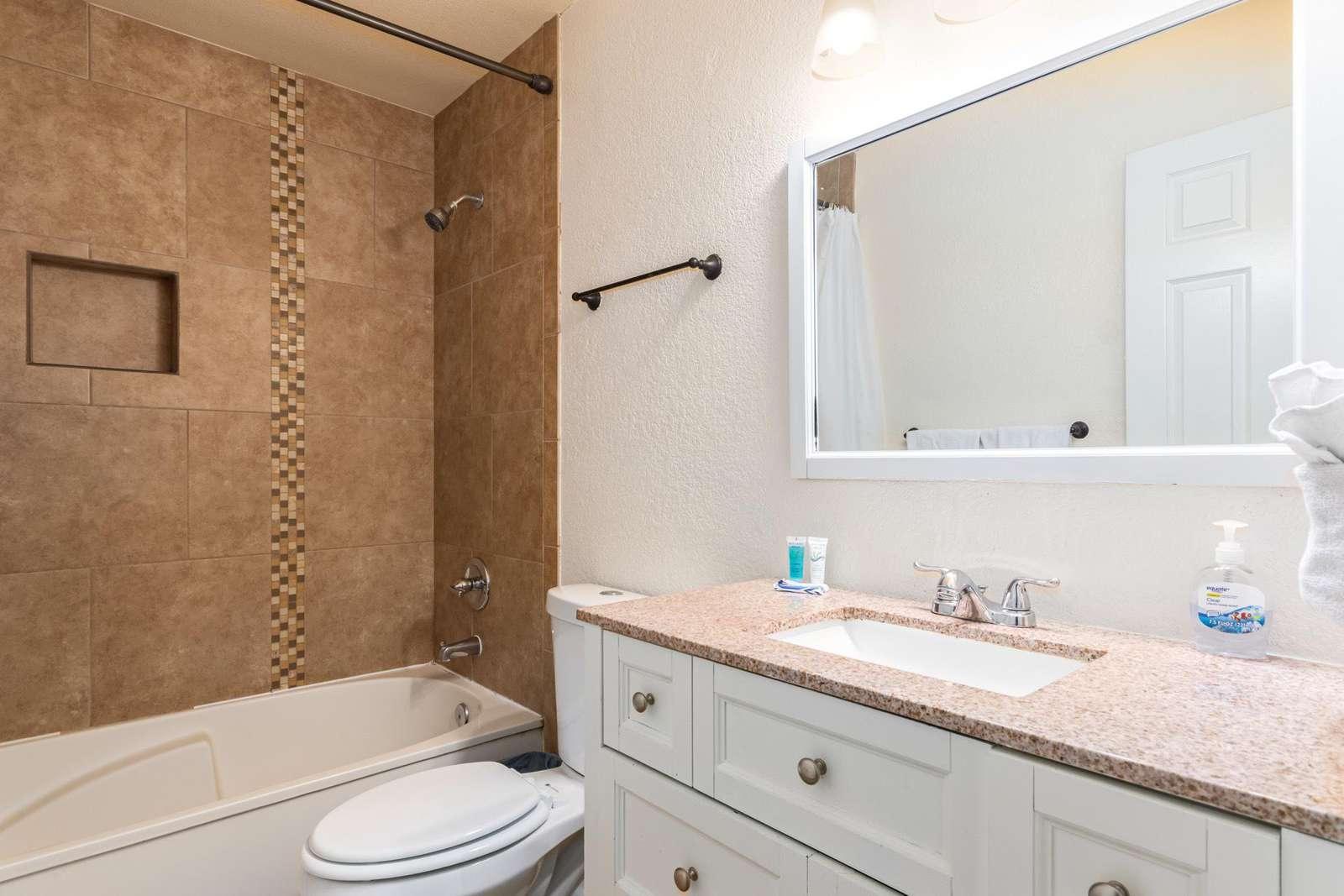 Main Bathroom Has A Tub/Shower Combination.
