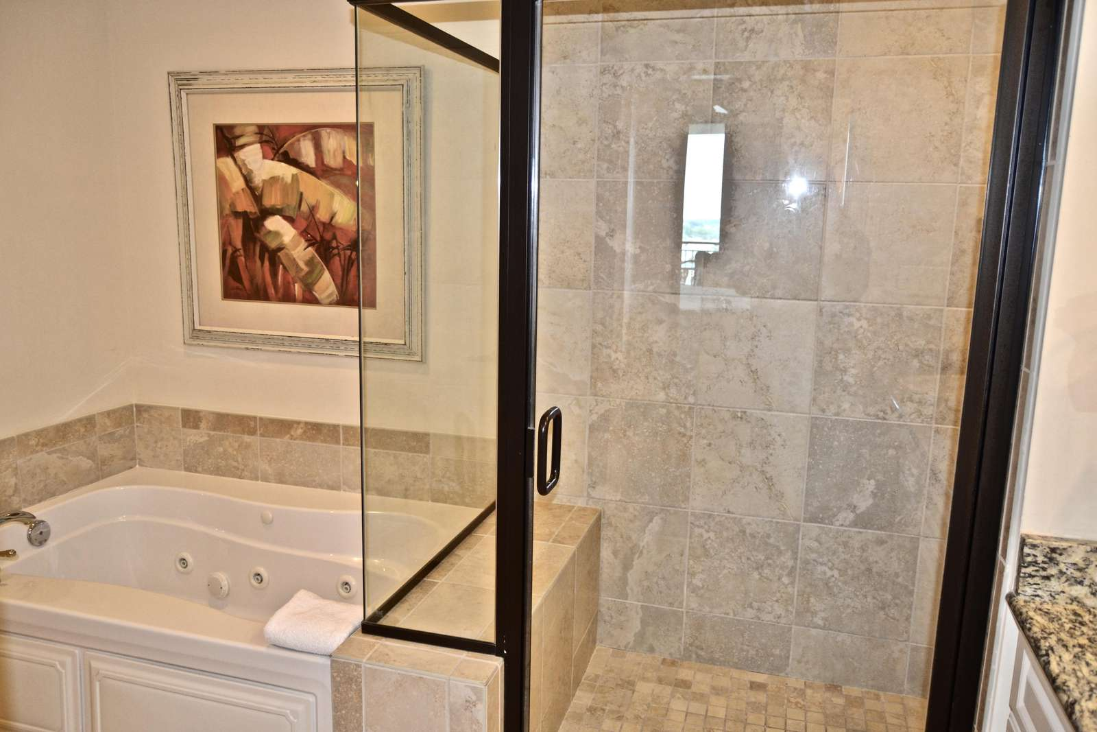 Jetted tub with walk-in ceramic tile shower, with seat
