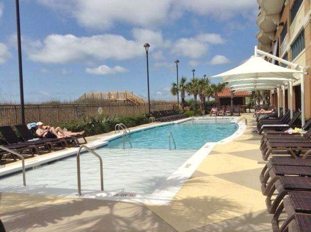 Outdoor pool and private beach access