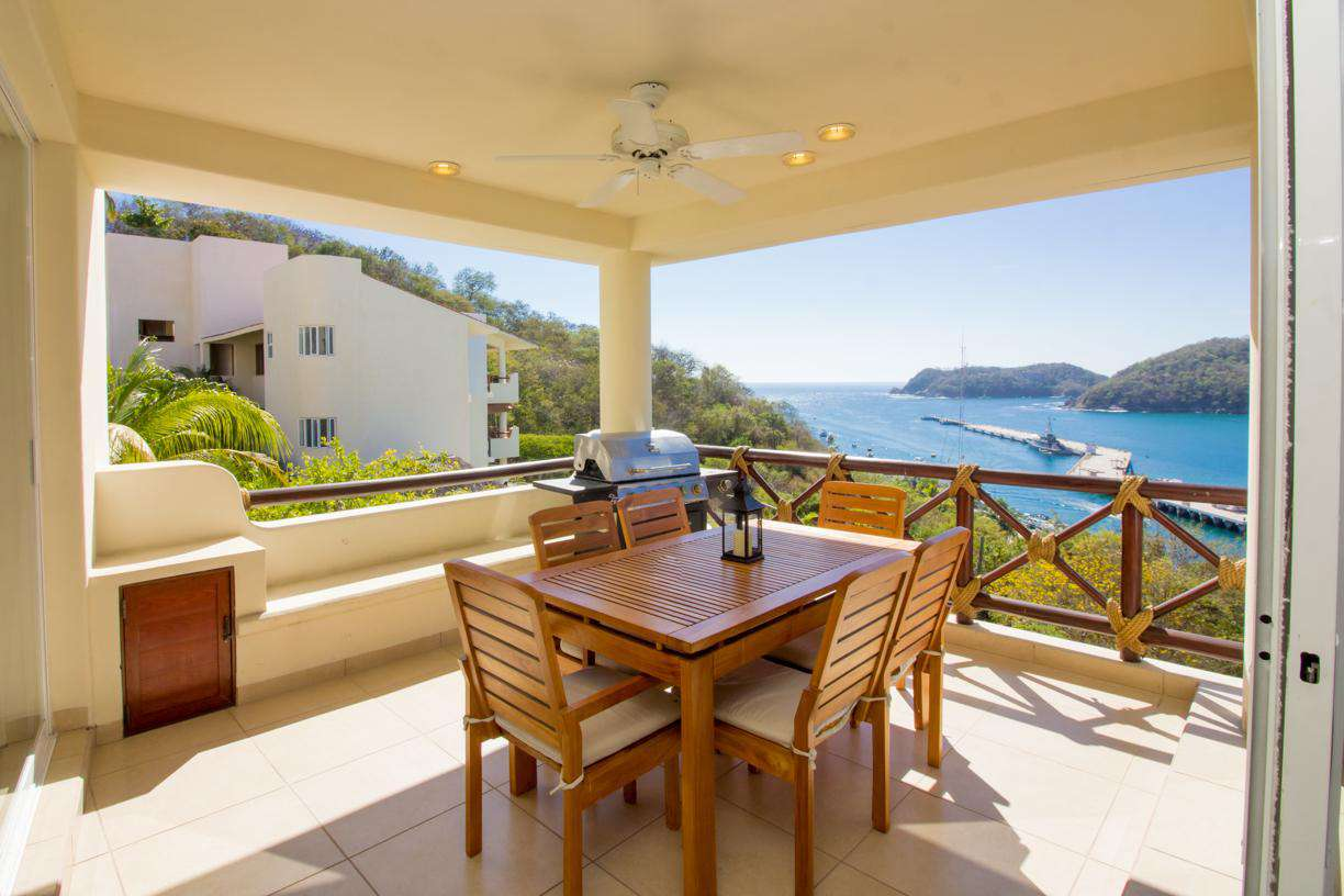 Outdoor terrace with propane BBQ, dining set and ocean views - property