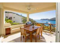 Outdoor terrace with propane BBQ, dining set and ocean views thumb