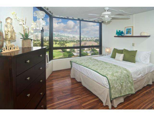 Enjoy cool trade winds and spectacular mountain views across the golf course