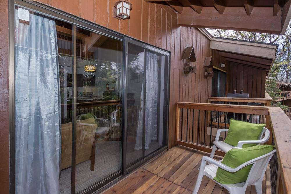 The deck with seating and electric grill.