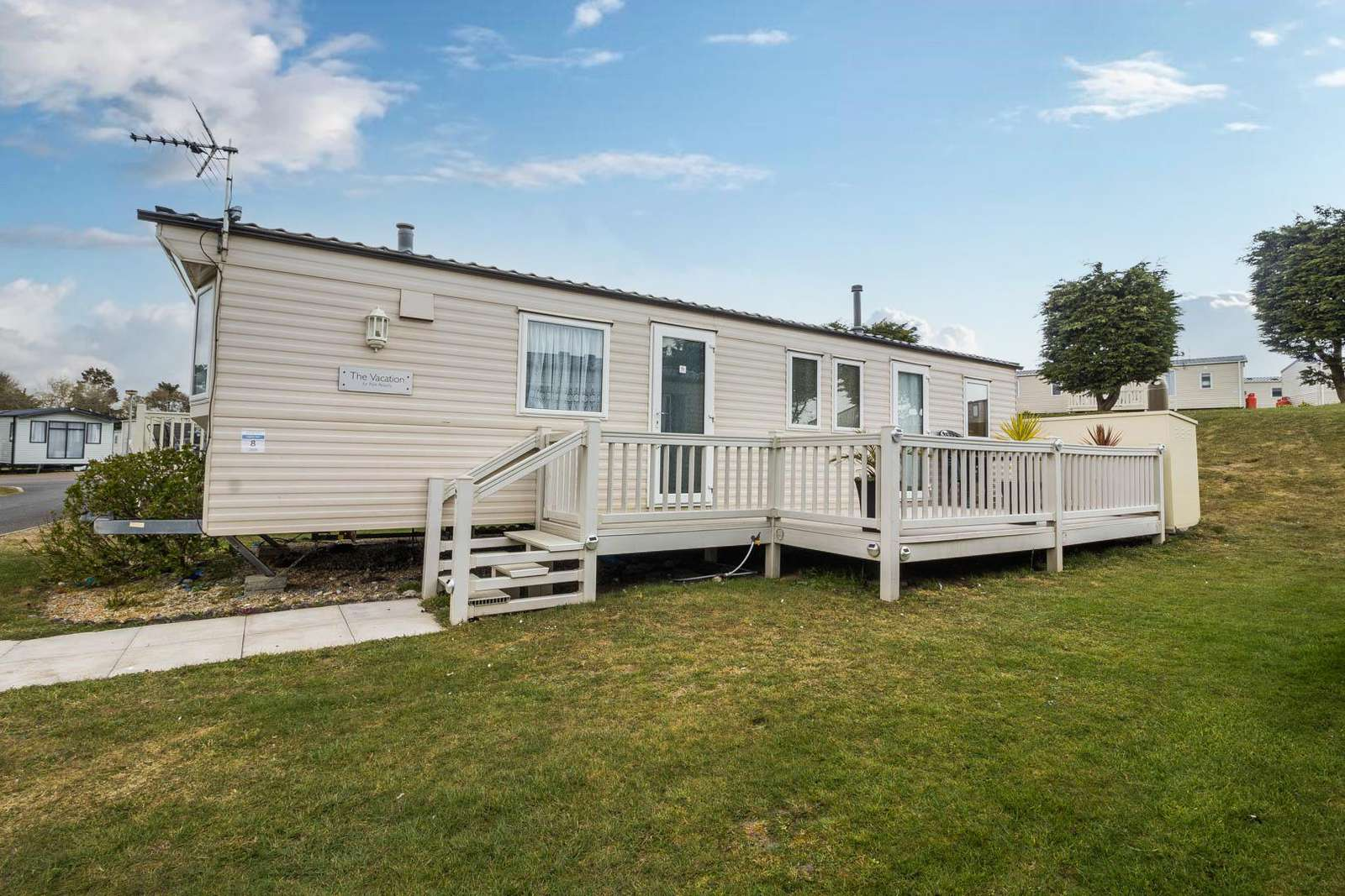 90008PW – Pebble Way area, 3 bed, 8 berth caravan with decking. Ruby rated. - property