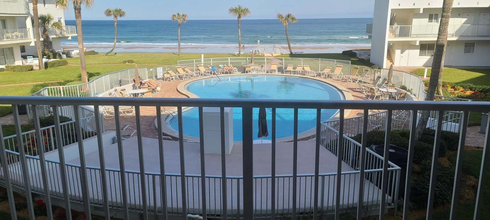 View from condo - just steps to the beach - property