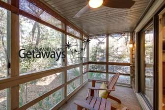The Screened-In Porch with Ceiling Fan and Peaceful Wooded Views thumb