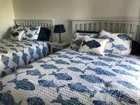 Queen beds in guest room thumb