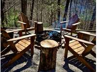 4 Teak Adirondack Chairs to Relax around the Fire Pit thumb