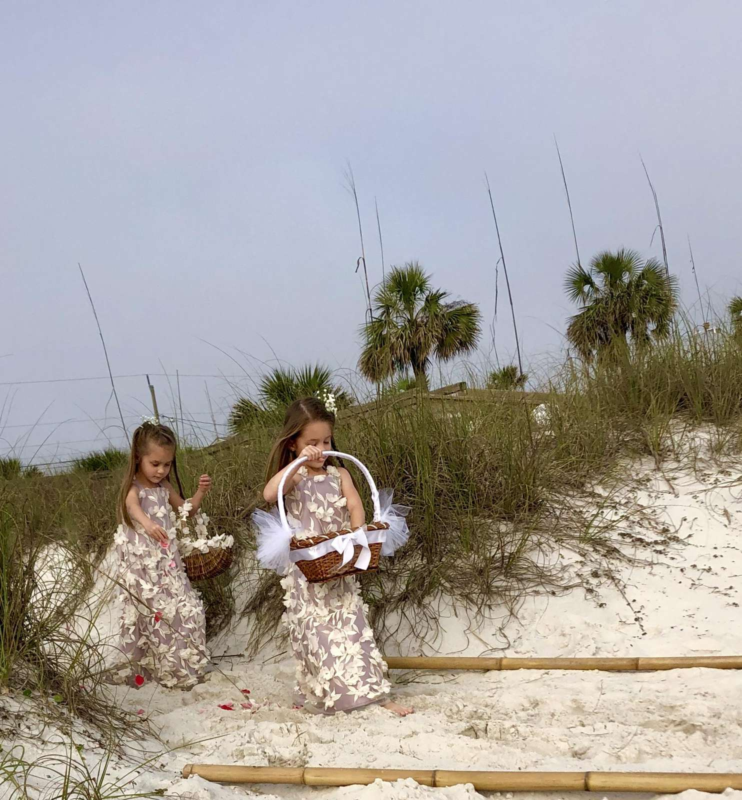 Flower girls making their way to the beach