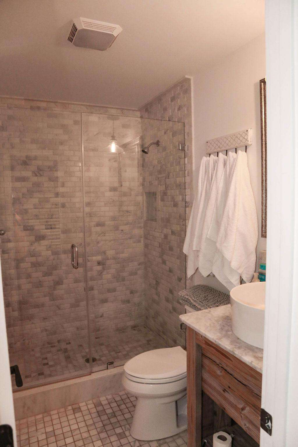 Br # 1 bathroom, white marble shower, glass doors