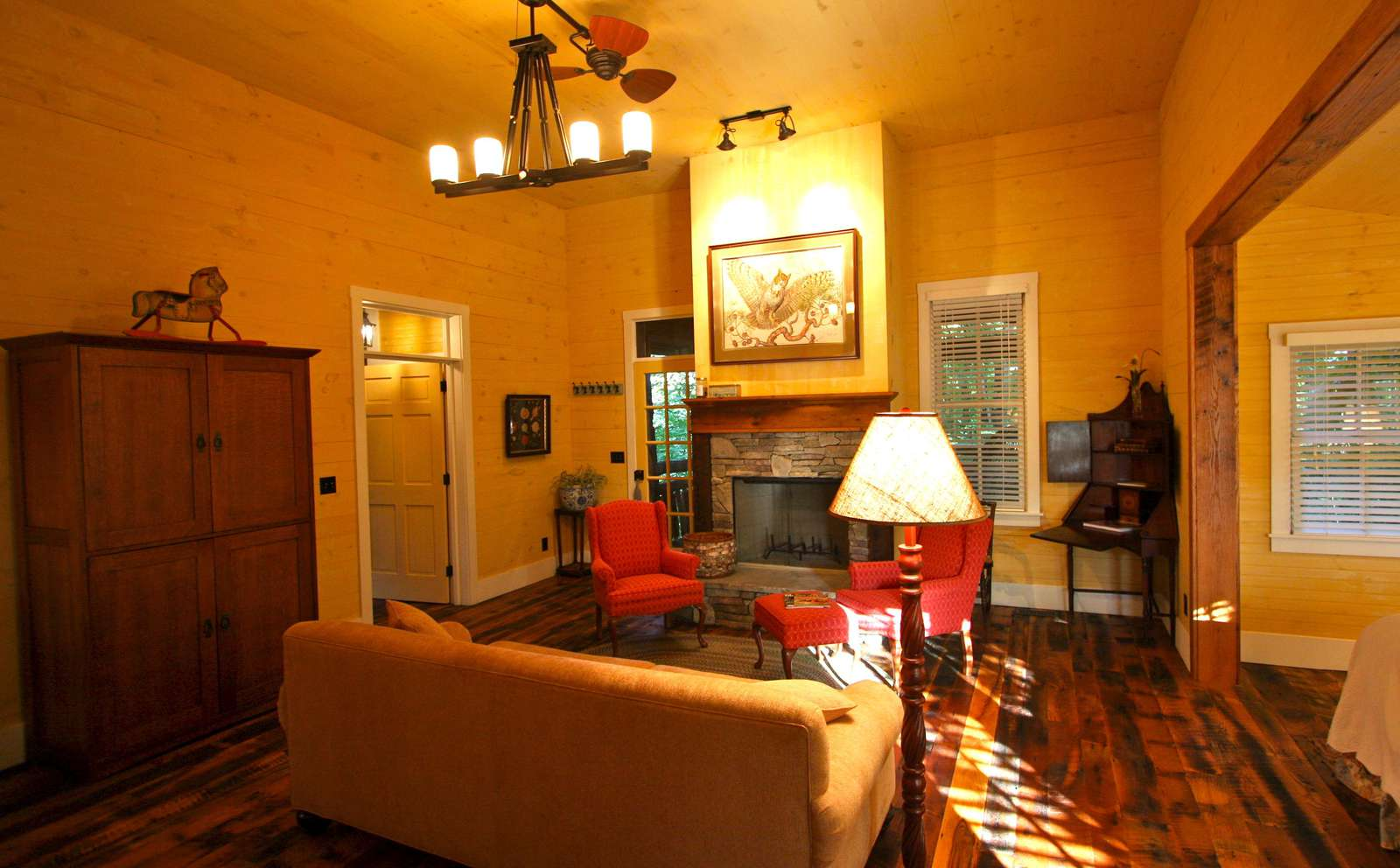 Living room with fireplace and backdoor to the porch