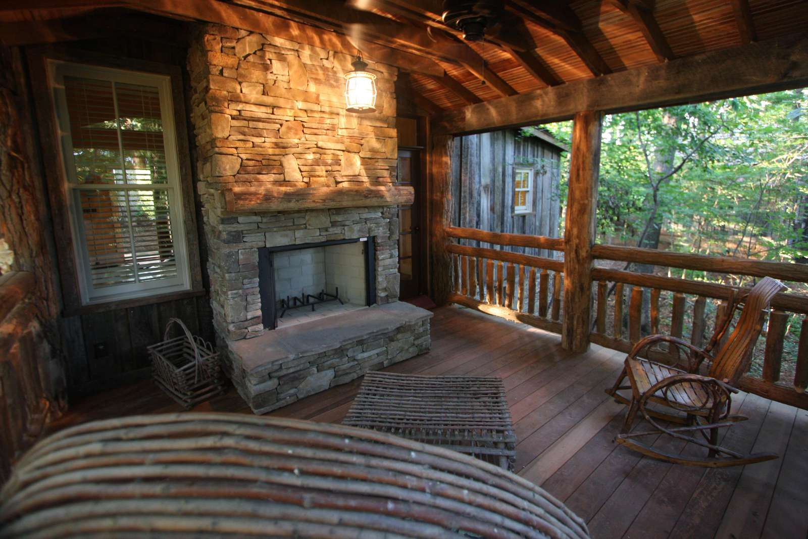Secluded back porch with fireplace