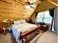 Loft is arranged as a Jr. Master Suite (Queen Bed), with 3rd TV and en-suite bathroom thumb