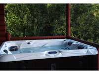 Hot Tub is very Private, Offers Long Range Mountain Views, and is accessible from the Master Suite! thumb
