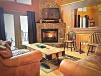 Main level Living Room is Cozy, and is ideal for gathering and entertaining thumb