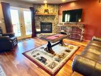 The Master Suite Offers a Luxurious King Bed, 2nd Fireplace, Private Living Room with 55