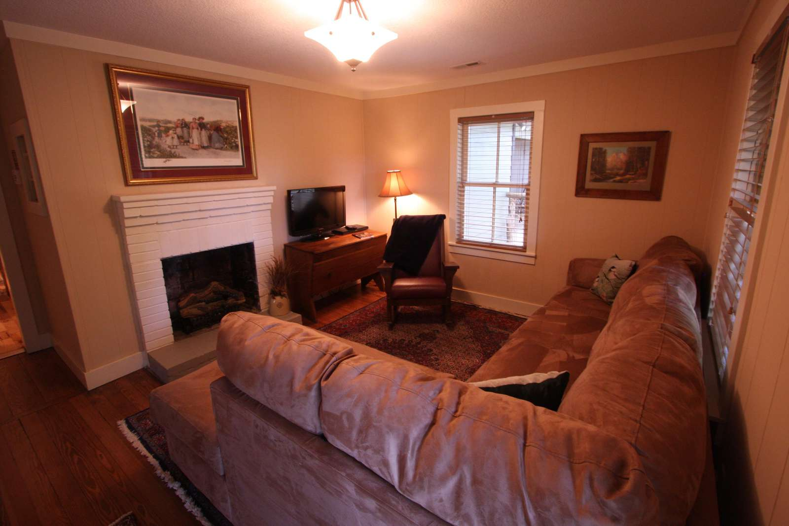 Living room with fireplace and cable TV