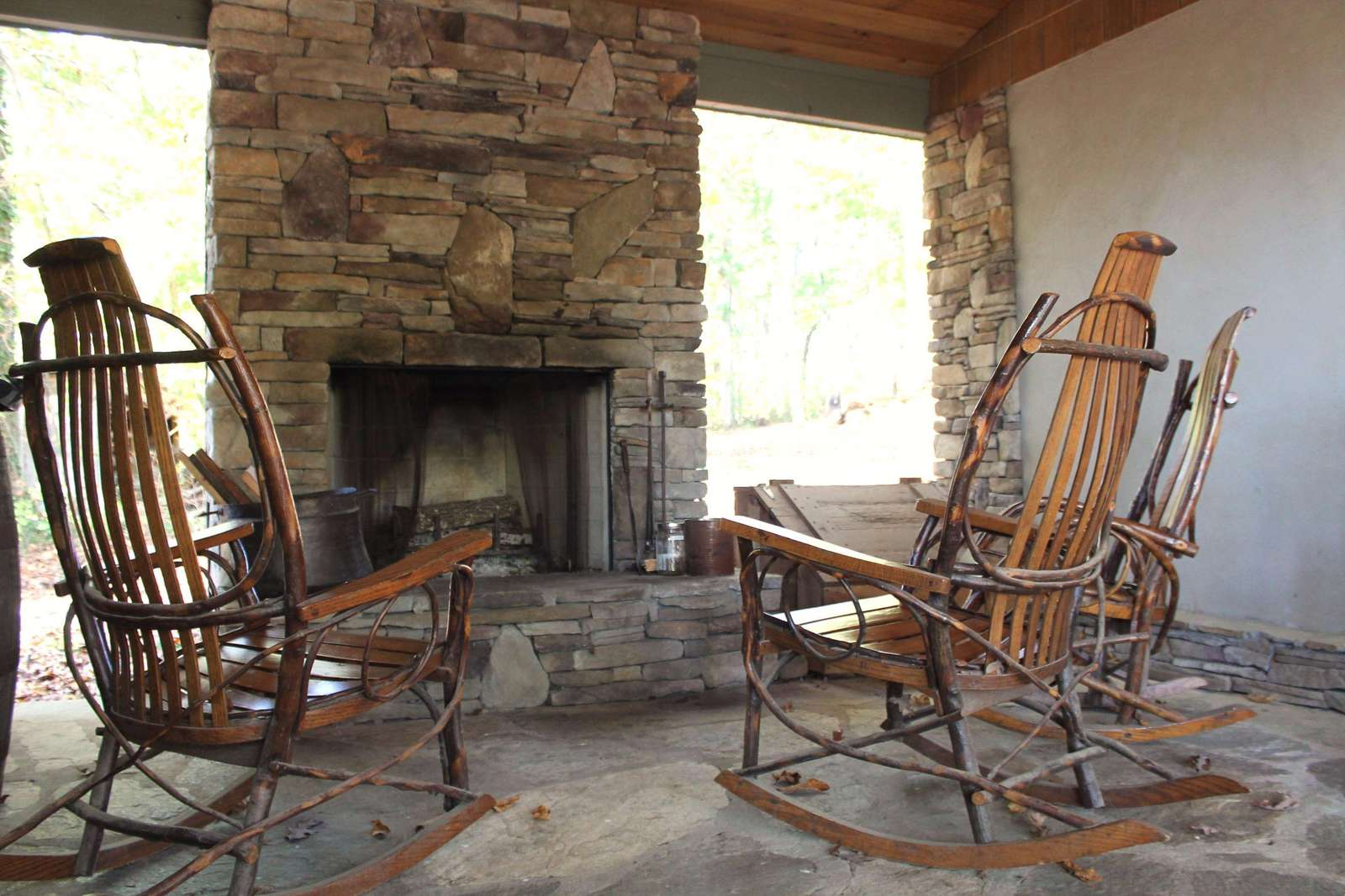 Cozy covered porch with wood-burning fireplace