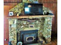 Massive Native Stone Fireplace with Wood Stove Inset thumb