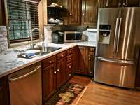 Upscale Stainless Appliances, and an upgraded Dishwasher (they did not have those in the olden days) thumb