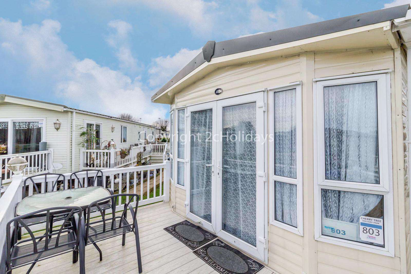 Beautiful large decking area with furniture to relax in - property