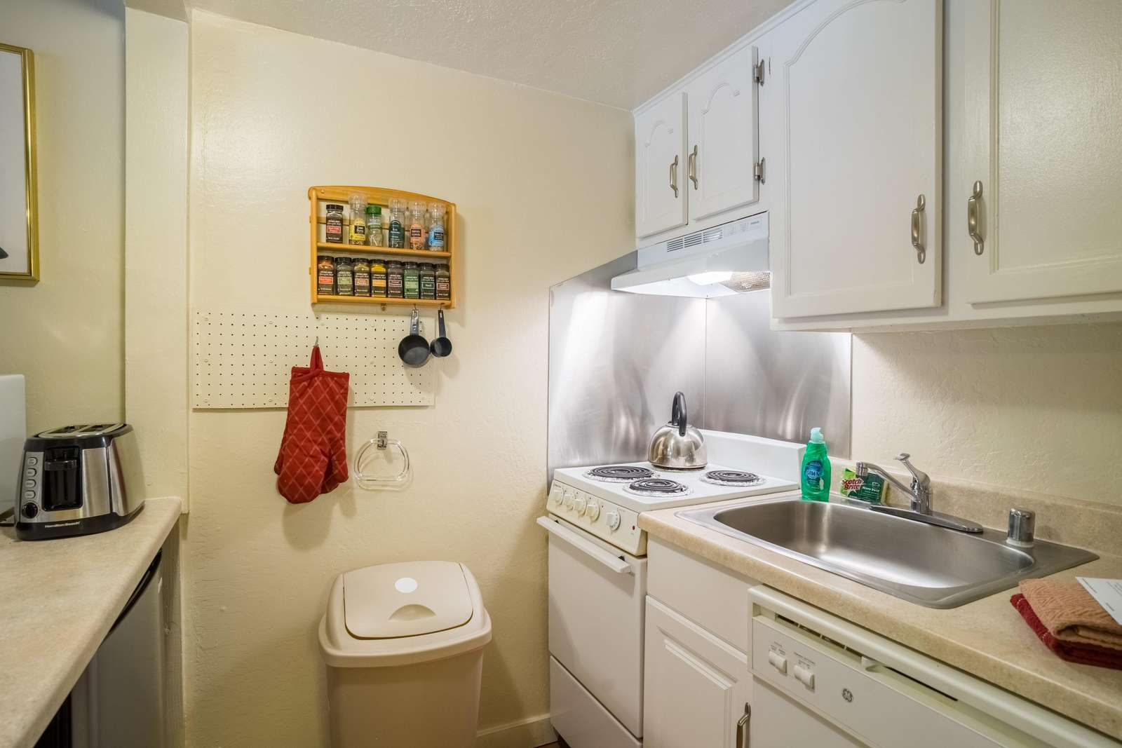 Kitchen includes dishes, pots & pans and utensils.