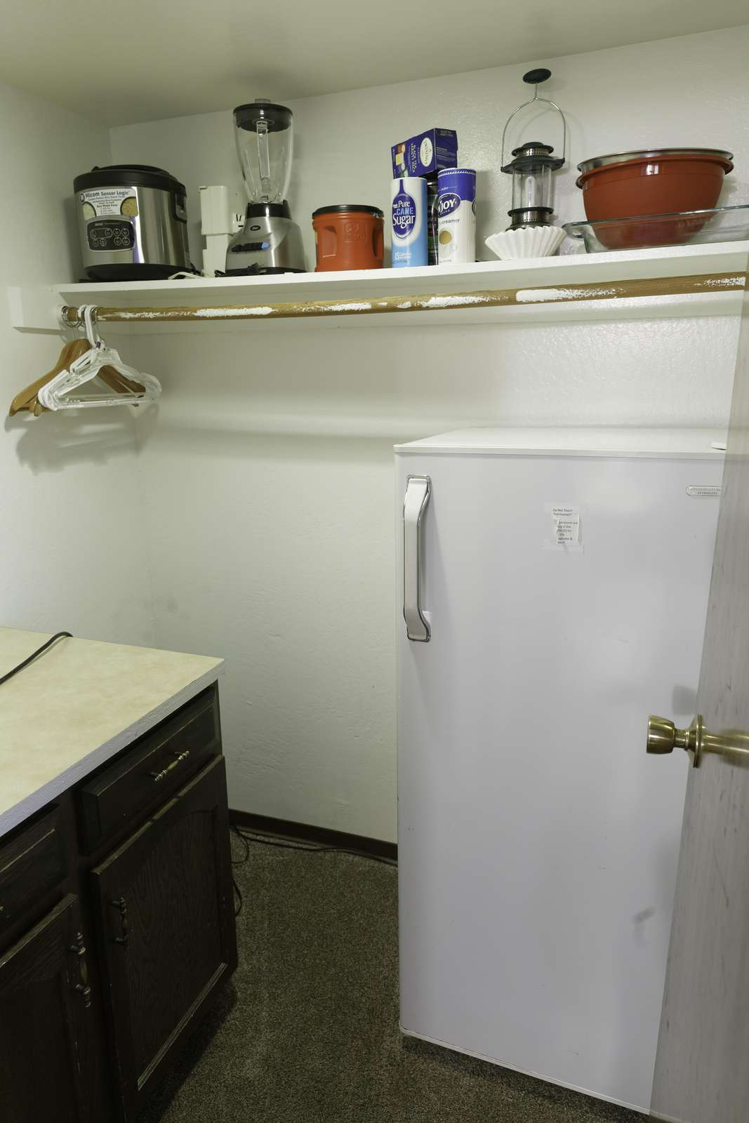 The refrigerator in the walk-in closet behind the kitchen.