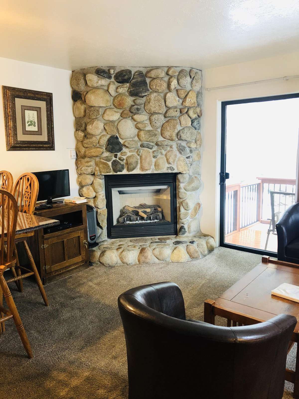 Dining area, gas fireplace and satellite TV.