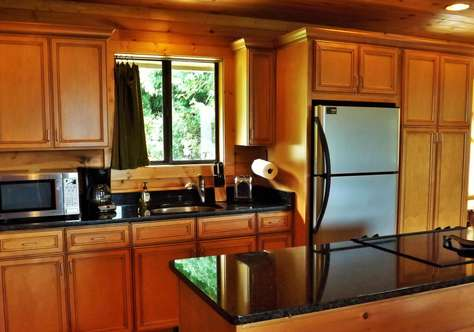 Well Appointed Kitchen with Granite and Stainless Appliances