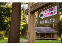 Red Maple Sign in front of the cabin thumb