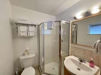 Main floor bathroom with shower thumb