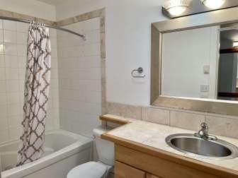 Top floor bathroom with tub/shower unit thumb
