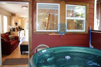 Hot Tub and doorway into cottage from the private deck thumb