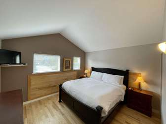 Master bedroom with a king bed and flat screen TV thumb