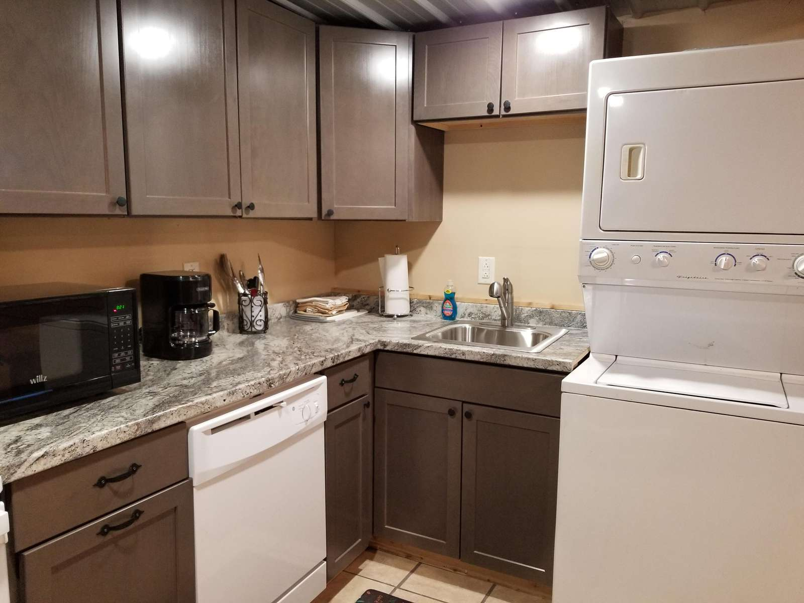 Kitchen and stacked washer/dryer