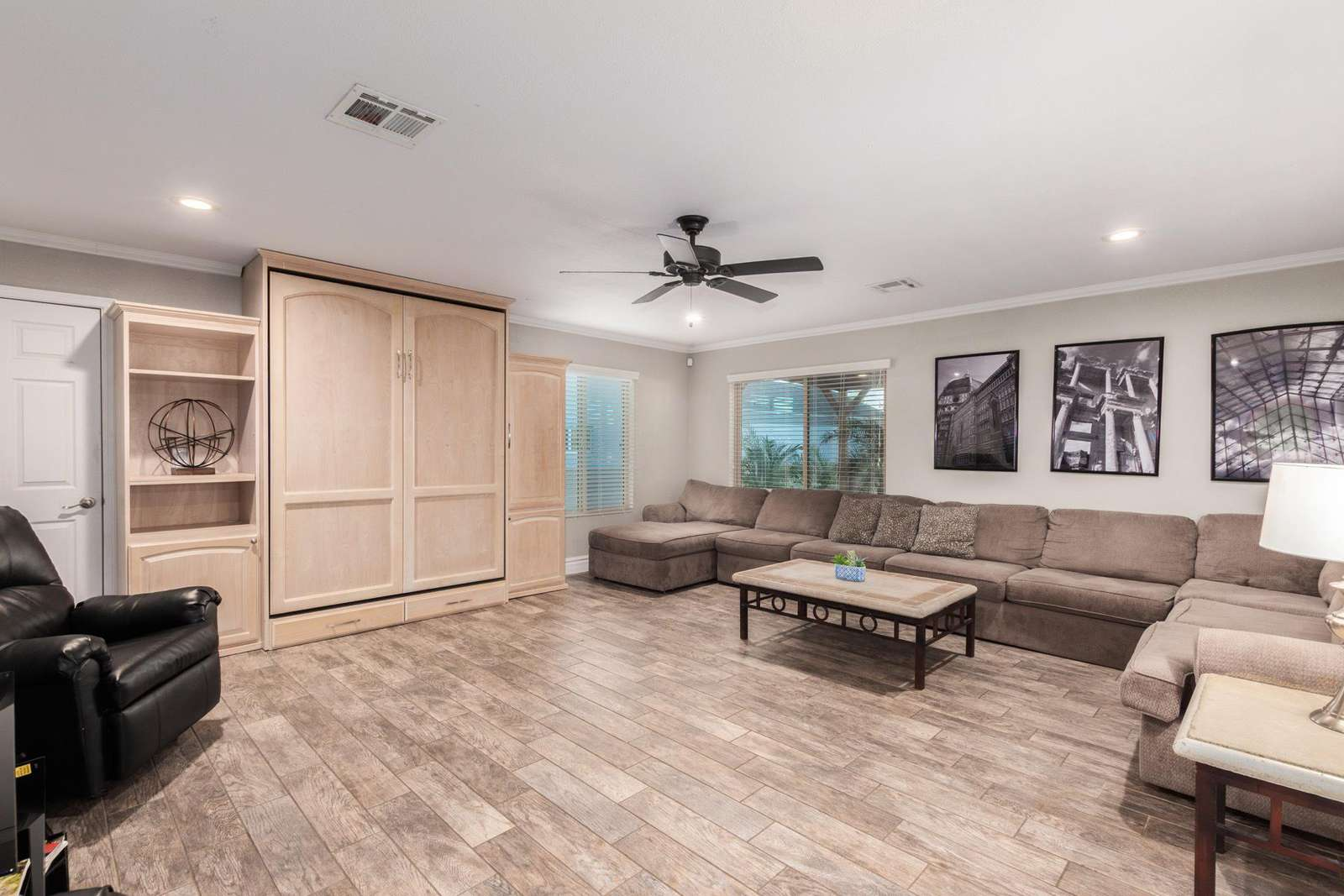 Spacious Living Room w/Queen Wall Bed and 20' Sectional.