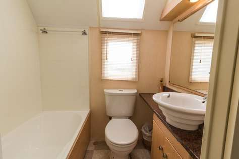 Bath and modern bathroom in this stunning Holiday Home in Hopton