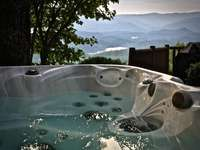 Hot Tub offers complete seclusion, star gazing, and a firefly show in the Summer! thumb